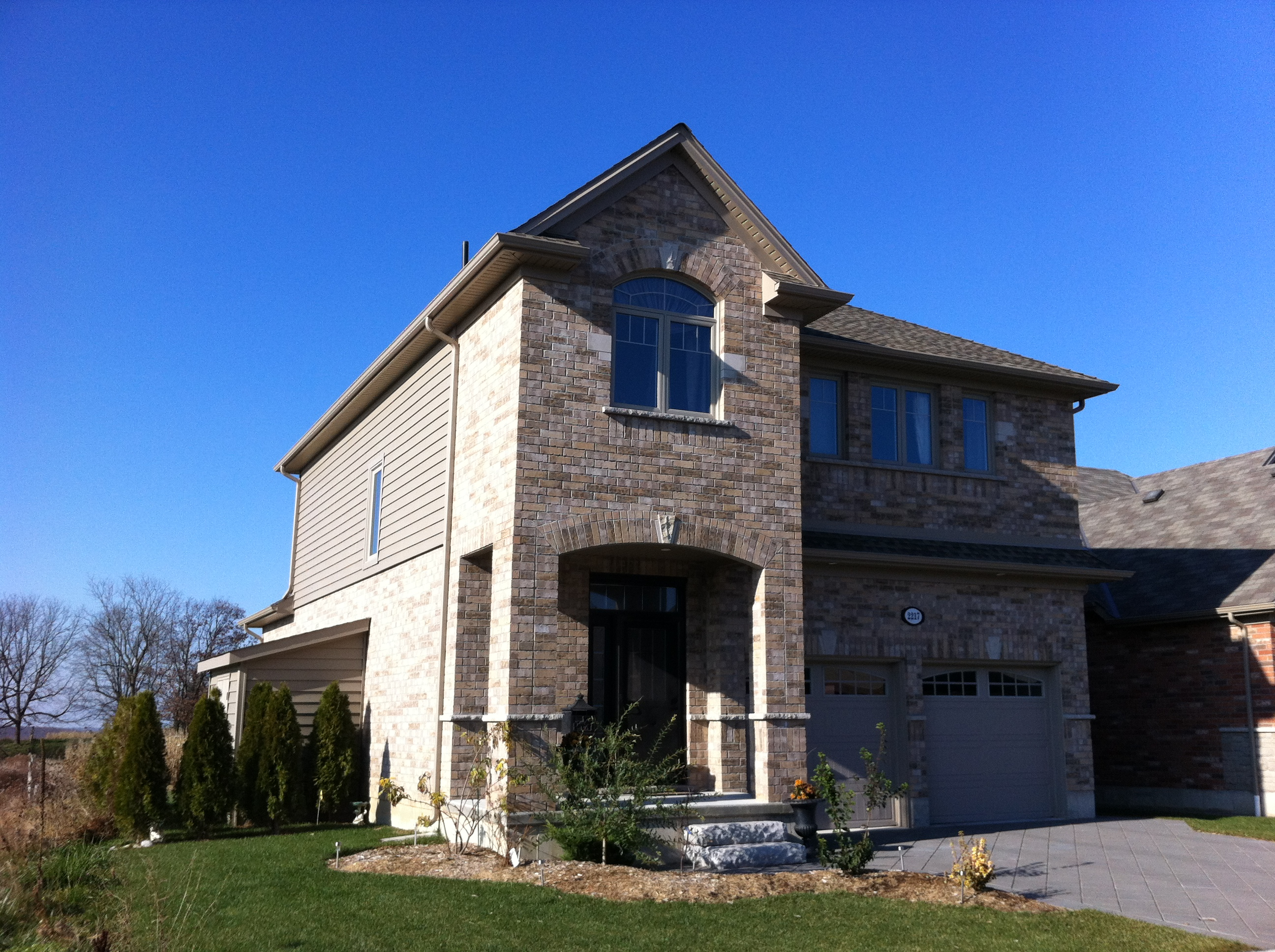 Insulated Backed Prodigy Siding, New Doors and Windows